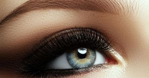 A close up of a woman's eye with makeup. Learn more about beauty school programs at Robert Paul Academy in Baltimore.