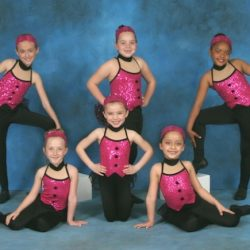 Dressed in glitter, these girls from our dance studio in Queens County are ready to rock