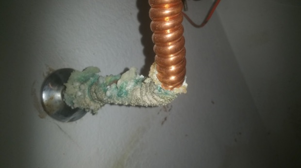Coiled copper pipe with calcification damage - Robins Plumbing Inc.
