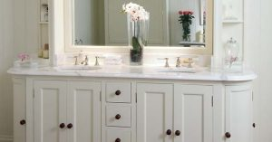 A white wood bathroom vanity - Robins Plumbing Inc.