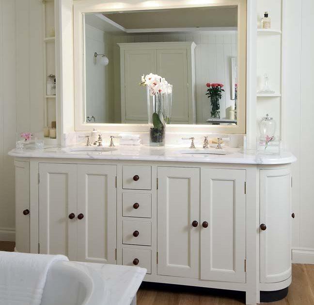 A white wood bathroom vanity - Robins Plumbing Inc.