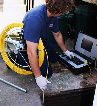 Plumber using a sewer inspection camera - Robins Plumbing