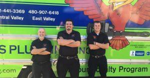 "3 plumbing technicians standing in front of green company van for blog ""Team Work Drives Customer Service"""