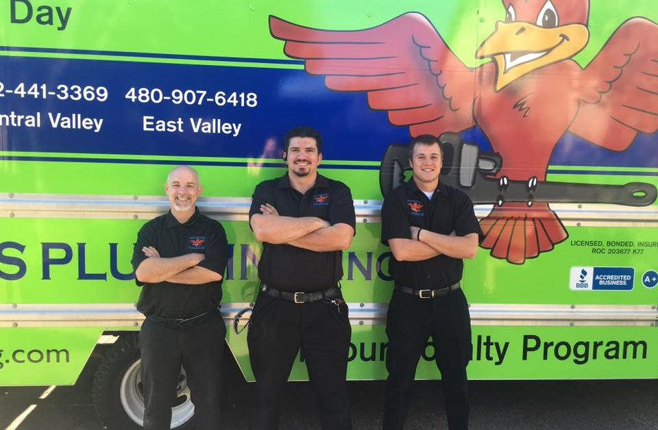 "3 plumbing technicians standing in front of green company van for blog ""Team Work Drives Customer Service"""