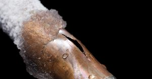 Busted copper pipe with frost forming on it - Robins Plumbing Inc.