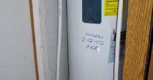 A white water heater - Robins Plumbing Inc.