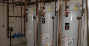 "Three water heaters in a commercial setting for blog ""Commercial Property Management"""