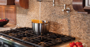 """Water pouring into a bowl of pasta on gas stove for blog """"Adding a Gas Line"""""""