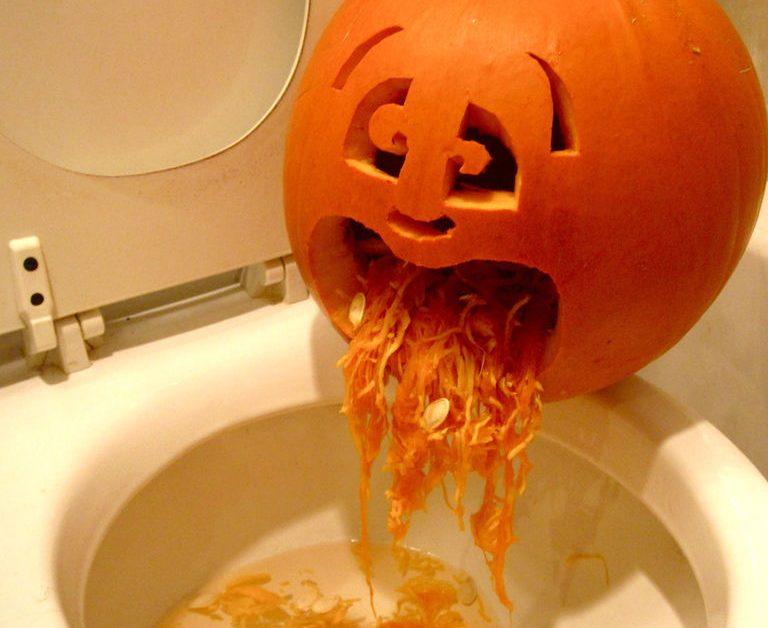 "Carved pumpkin ""throwing up"" the insides on a toilet (sick pumpkin) for blog ""Pumpkin Seeds"""