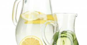 """Two pitchers of water, one with lemons and one with cucumbers as cover photo for blog """"Hard Water Spots and How I Stopped Them"""""""