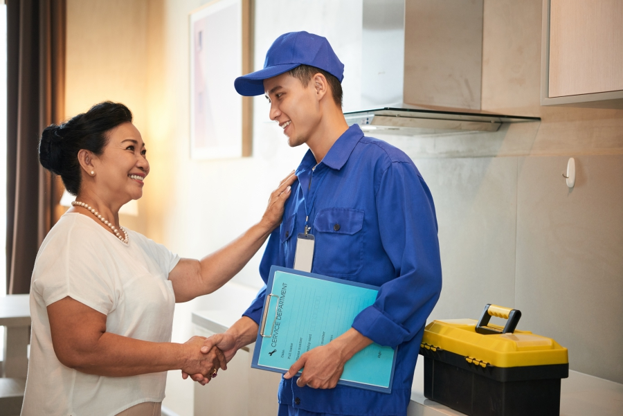 Technician and client shaking hands