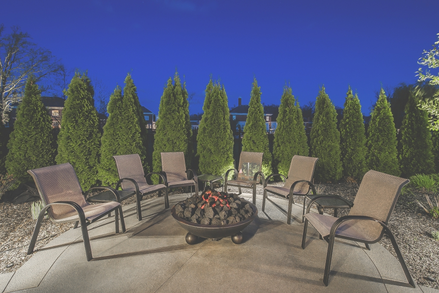 Image of six patio chairs around a fire pit