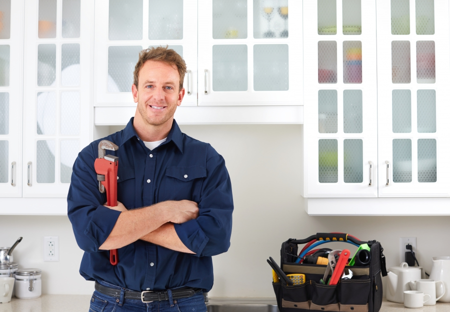 Image of a man holding a wrench