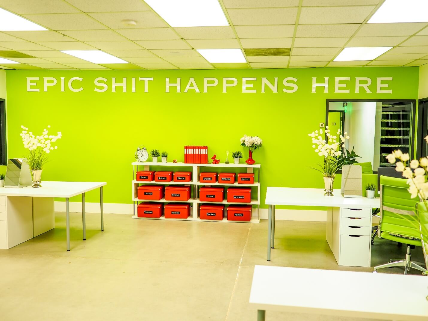 """Image of dispatch office with the saying """"epic shit happens here"""" shown on wall"""