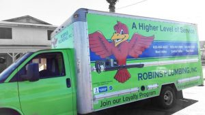 "Green Robins Plumbing truck that reads ""A Higher Level of Service"" for service page ""Our Values"" from ""About Us"" tab"