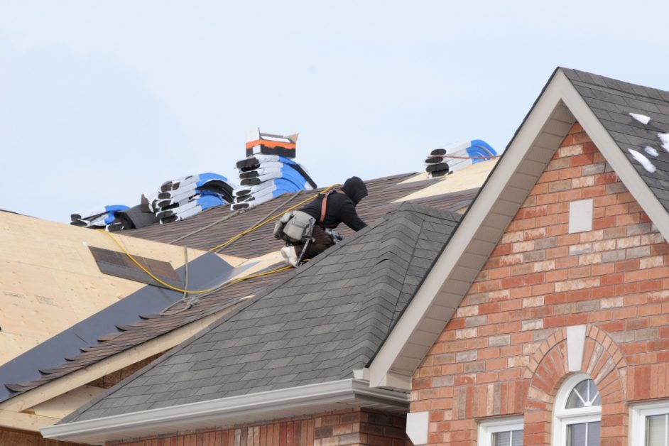 Workers Installing Shingle Roof