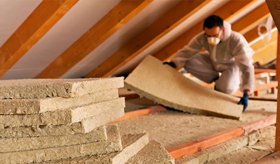Worker Installing New Insulation in Attic
