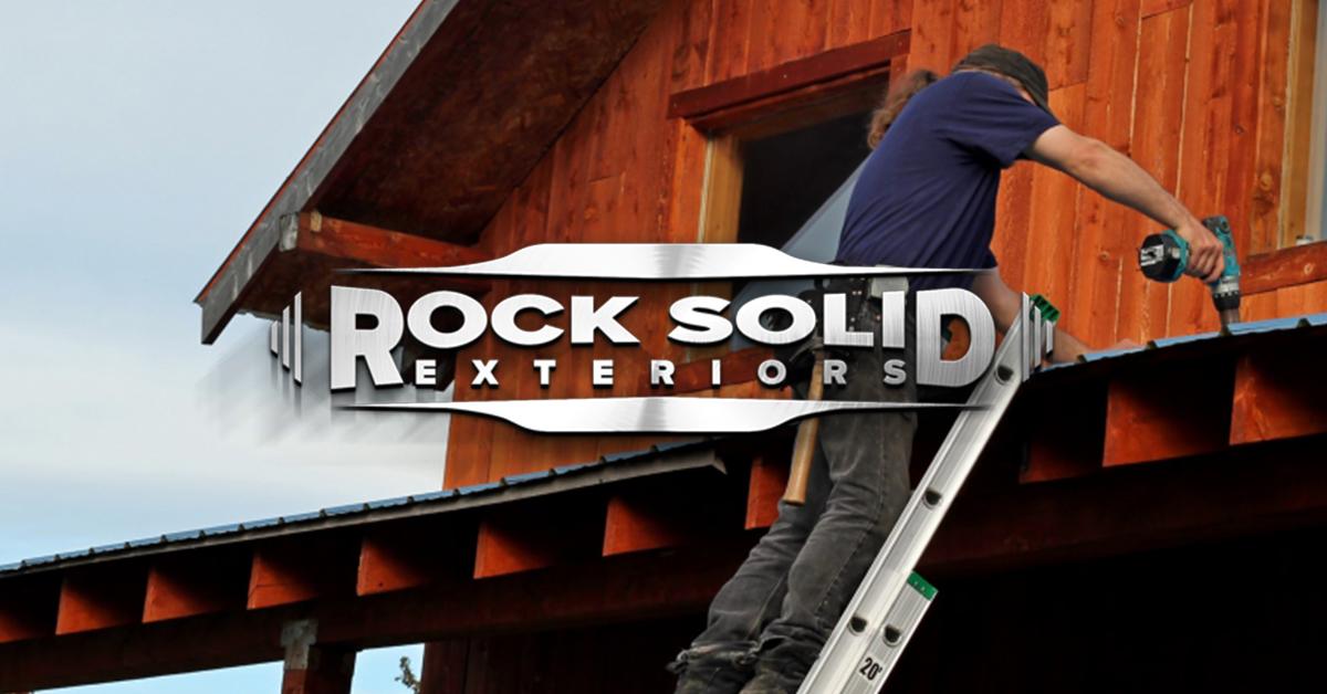 Worker Installing New Metal Roof