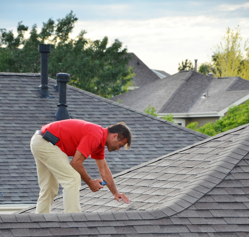 Inspector Checking Asphalt Shingle Roof