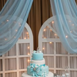 A blue and white wedding cake at Royal Palace Ballrooms