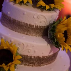 Sunflower decorated cake at event at Royal Palace Ballrooms