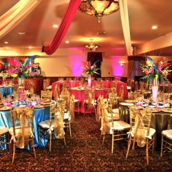 Blue and pink decorated tables in banquet hall at Royal Palace Ballrooms
