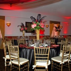 Black and Red themed tables at an event at Royal palace ballrooms