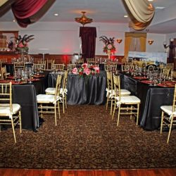 Black and red decorated tables at an event at Royal Palace Ballrooms