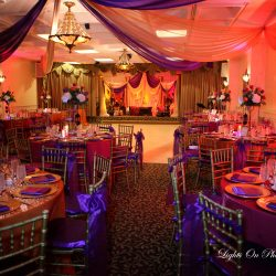 Orange and purple decorated event at Royal Palace Ballrooms