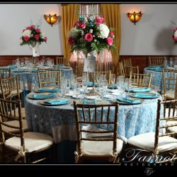 Flower arrangements and set tables at our Royal Palace Ballroom banquet hall