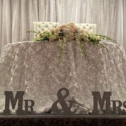 Mrs. & Mrs. signs at a wedding at Royal Palace Ballrooms