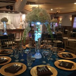 Wedding table decorations with glowing vases at Royal Palace Ballrooms