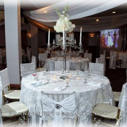 All white tables at a wedding reception at Royal Palace Ballrooms