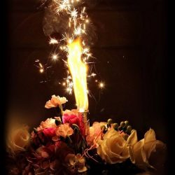 Flower arrangement with fire at an event at Royal Palace Ballrooms