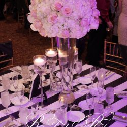 An event table with flowers and candles at Royal Palace Ballrooms