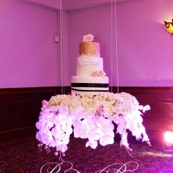 Floating cake with flowers for a wedding at Royal Palace Ballrooms