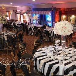 Beautifully decorated chairs at a themed event at Royal Palace Ballrooms