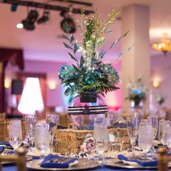 Close up of blue and white flower arrangement at an event at Royal Palace Ballrooms