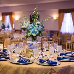 Blue, beige, and white set table at an event at Royal Palace Ballrooms