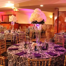 Wedding reception tables with flower arrangements at Royal Palace Ballrooms