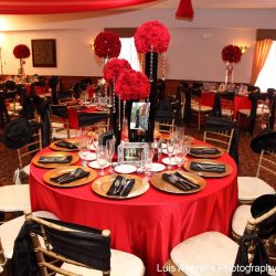 Red and black decorated tables at an event at Royal Palace Ballrooms