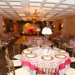 White and pink decorated tables at a birthday party at Royal Palace Ballrooms