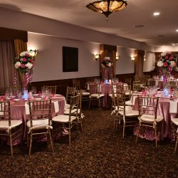 Pink tables with white at an event at Royal Palace Ballrooms