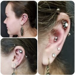 Industrial piercing with a 14 gauge internally threaded bar and an opal adornment