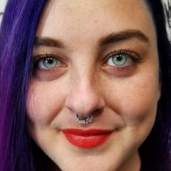 Septum piercing with a 16 gauge hanging hinged hoop.