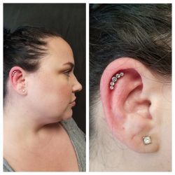 Outer conch piercing with a 16 gauge internally threaded 5 stone crescent cluster in clear CZ.