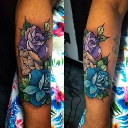 Full color neo-traditional tattoo of roses with a diamond on the forearm.