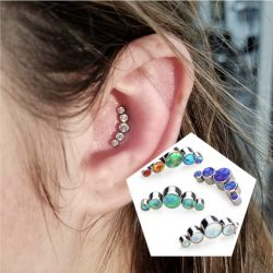 Inner conch piercing with a 16 Gauge internally threaded 5 stone crescent cluster in CZ.