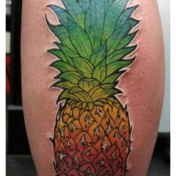 Full color realism tattoo of a pineapple with a rainbow color blend on the thigh.
