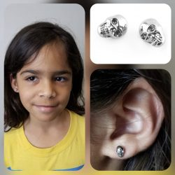 Ear piercings with 18 gauge internally threaded, stainless steel skull tops.